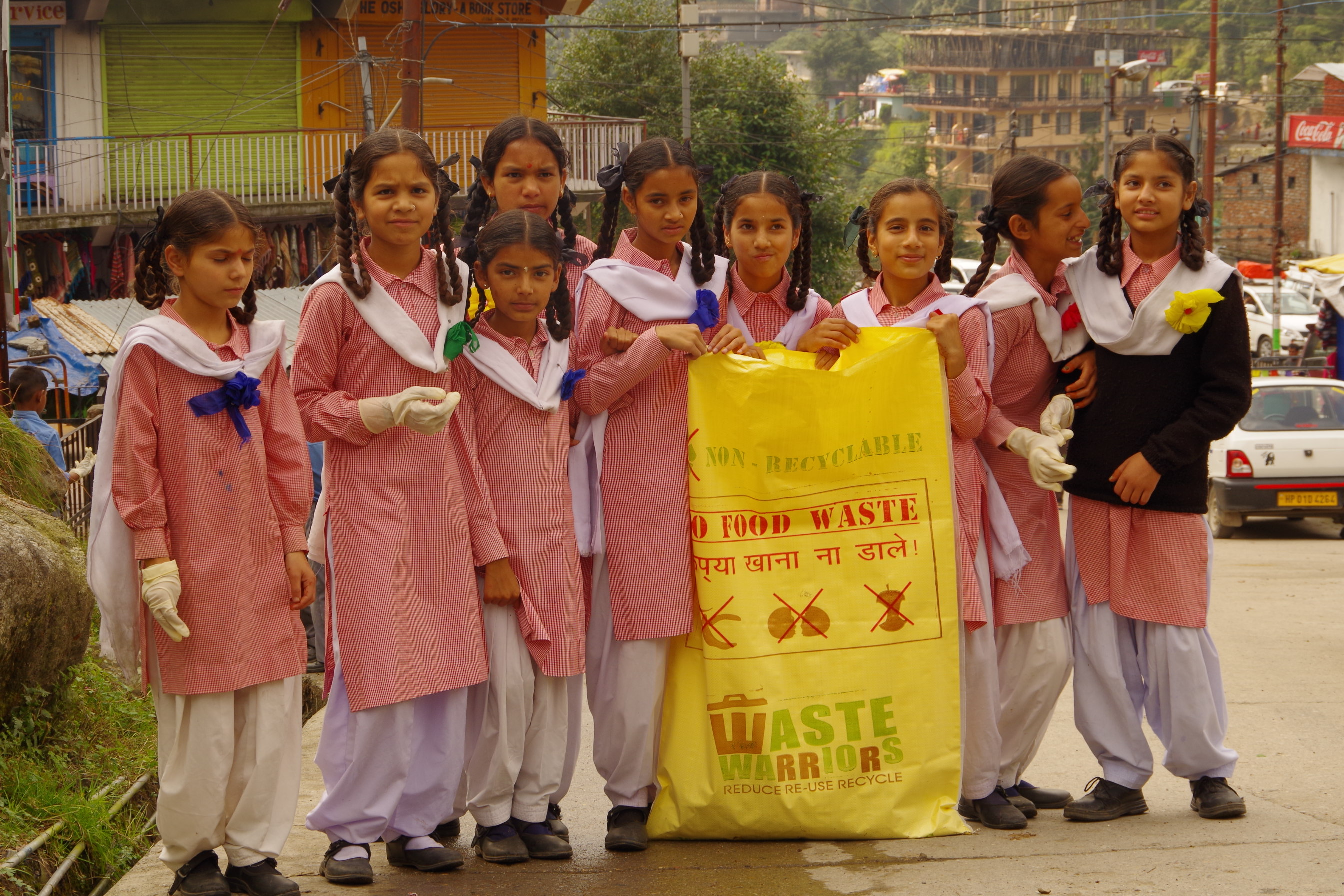 School children ready to begin a community clean-up session