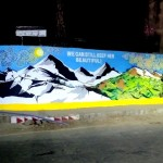 A wide-angle view of the entire Waste Warriors Gandhi Park mural at night
